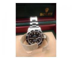 Relógio marca Rolex modelo submarino todo em aço