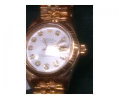 Relógio marca Rolex modelo lerd feminino todo em ouro brilhantes